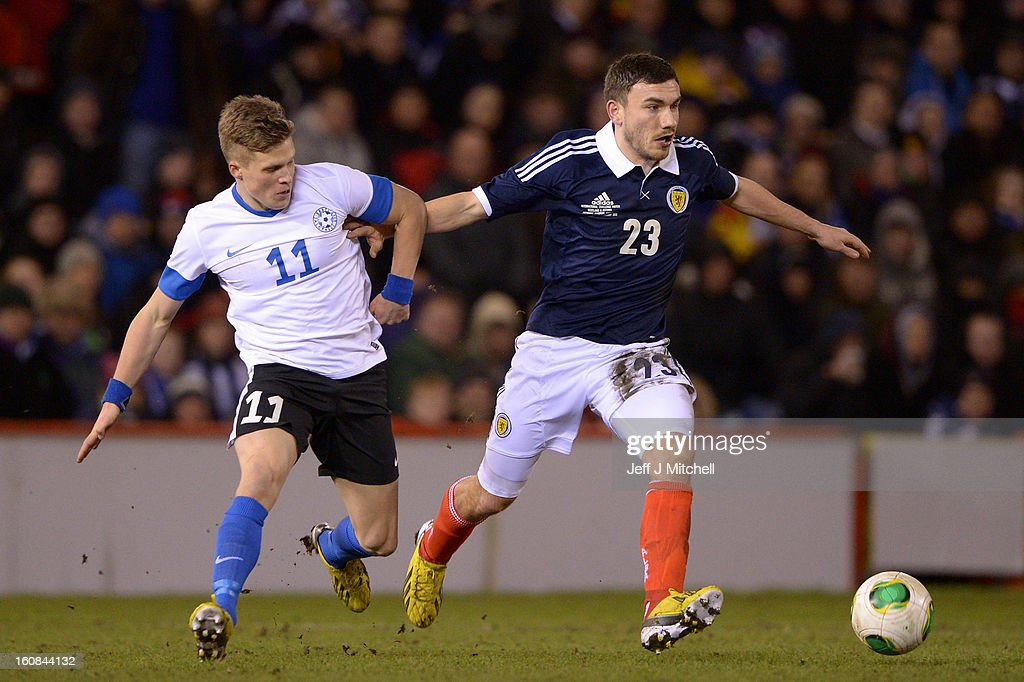 Robert Snodgrass of Scotland tackles Henrik Ojamaa of Estonia during the international friendly match between Scotland and Estonia at Pittodrie Stadium on February 6, 2013 in Aberdeen, Scotland.