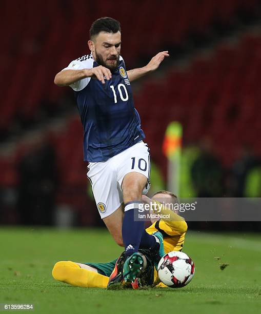 Robert Snodgrass of Scotland vies with Karolis Chvedukas of Lithuania during the FIFA 2018 World Cup Qualifier between Scotland and Lithuania at...