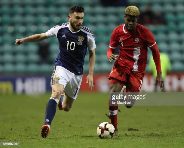 Robert Snodgrass of Scotland vies with Manjrekar James of Canada during the International Challenge Match between Scotland and Canada at Easter Road...