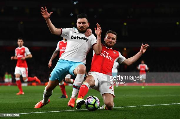 Robert Snodgrass of West Ham United and Shkodran Mustafi of Arsenal battle for possession during the Premier League match between Arsenal and West...