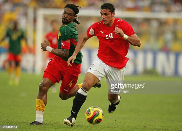 Robert Song of Cameroon competes with Zaky Mansour of Egypt during the AFCON Final between Egypt and Cameroon at the Ohene Djan stadium on February...
