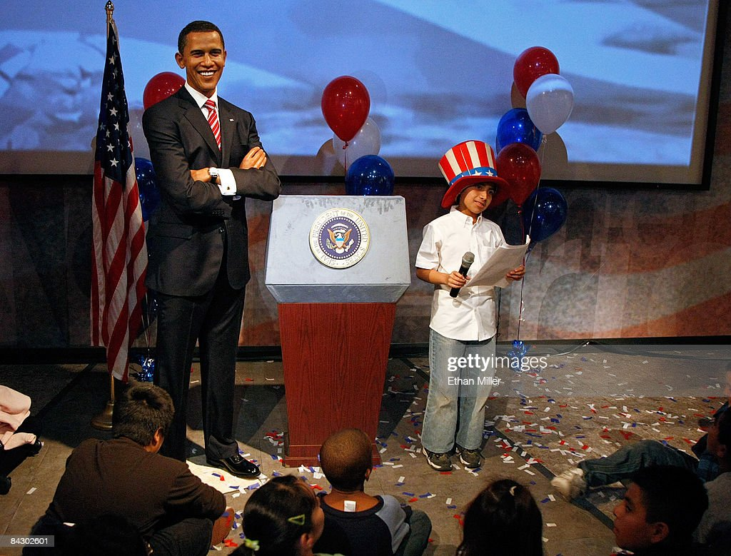 barack obama wax figure unveieled at madame tussauds las vegas robert soto reads an essay as part of a class field trip while standing next to
