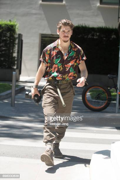 Robert Spangle wears a floral shirt and ACRONYM pants during Milan Men's Fashion Week Spring/Summer 2018 on June 19 2017 in Milan Italy