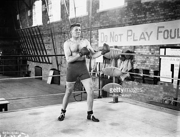 Robert Spiller a petty officer on board HMS Pembroke and promising boxer spars in a gymnasium ring