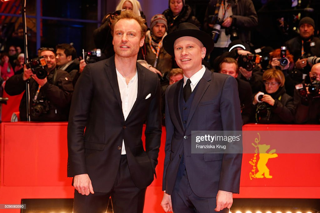Robert Stadlober (R) attends the 'Hail, Caesar!' premiere during the 66th Berlinale International Film Festival Berlin at Berlinale Palace on February 11, 2016 in Berlin, Germany.