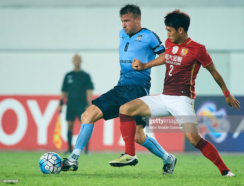 Robert Stambolziev of Sydney FC (L) competes for the ball with Liao Lisheng of Guangzhou Evergrande (R) during the AFC Asian Champions League match between Guangzhou Evergrande FC and Sydney FC at Tianhe Stadium on May 3, 2016 in Guangzhou, China.