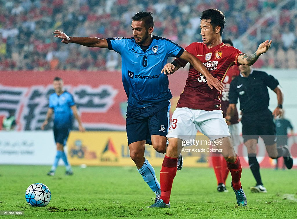 Robert Stambolziev of Sydney FC (L) competes for the ball with Rong Hao of Guangzhou Evergrande (R) during the AFC Asian Champions League match between Guangzhou Evergrande FC and Sydney FC at Tianhe Stadium on May 3, 2016 in Guangzhou, China.