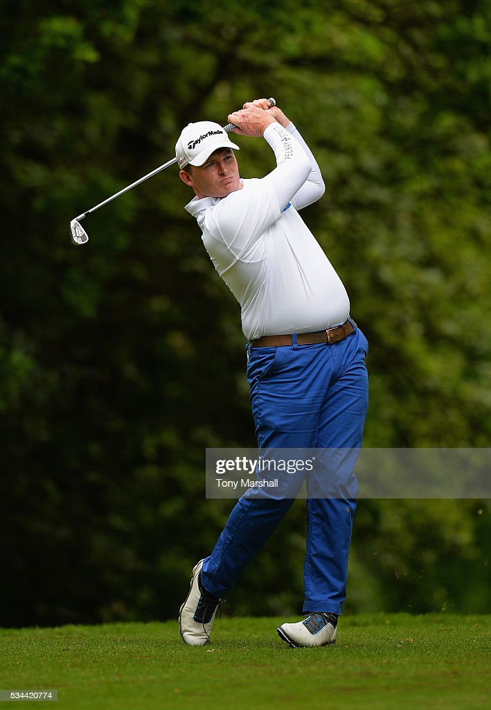 Robert Steele of Ladbrook Park Golf Club plays his first shot on the 17th tee during the PGA Assistants Championships - Midlands Qualifier at the Coventry Golf Club on May 26, 2016 in Coventry, England.