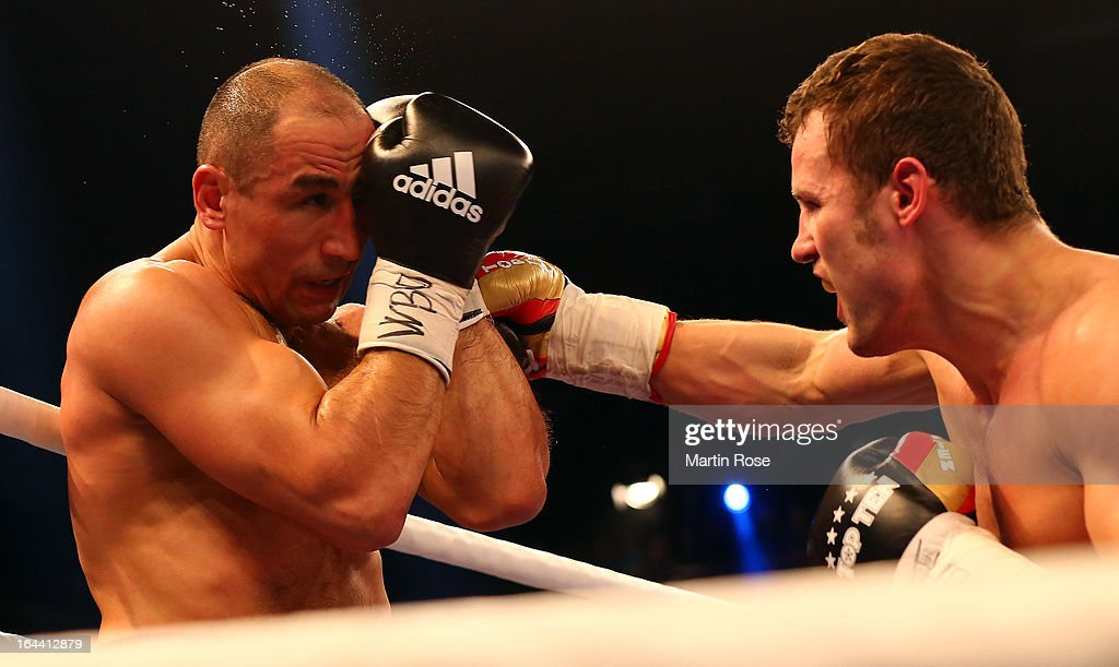 Robert Stieglitz (R) of Germany and Arthur Abraham (L) of Germany exchange punches during the WBO World Championship Super Middleweight title fight at Getec Arena on March 23, 2013 in Magdeburg, Germany.