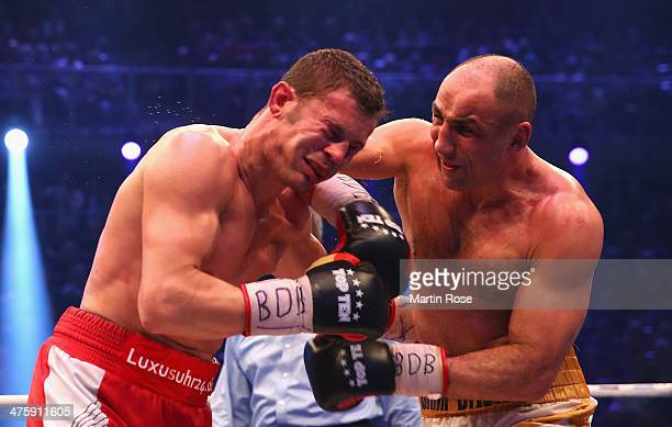Robert Stieglitz of Germany and Arthur Abraham of Germany exchange punches during the WBO World Championship Super Middleweight title fight at Getec...