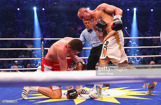 Robert Stieglitz of Germany is knpocked down by Arthur Abraham of Germany during the WBO World Championship Super Middleweight title fight at Getec...