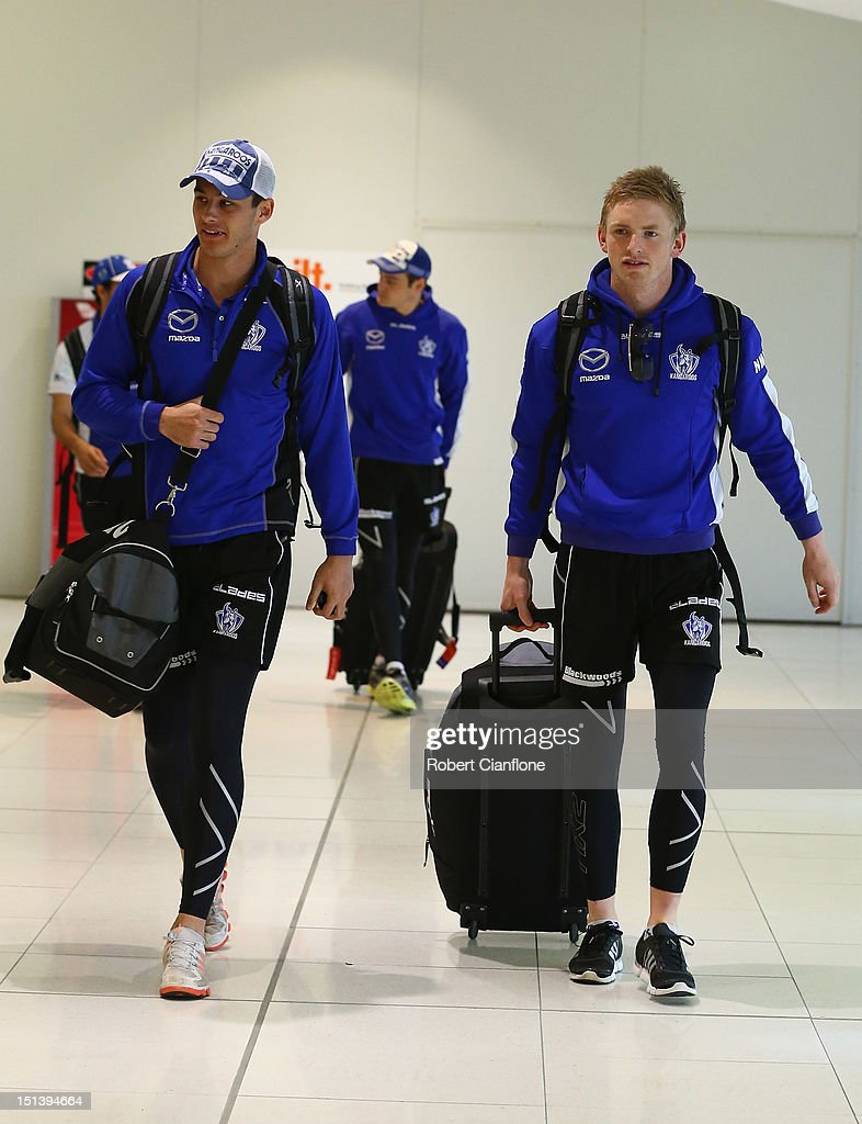 Robert Tarrant and Jack Ziebell of the Kangaroos arrive at Melbourne Airport on September 7, 2012 in Melbourne, Australia.