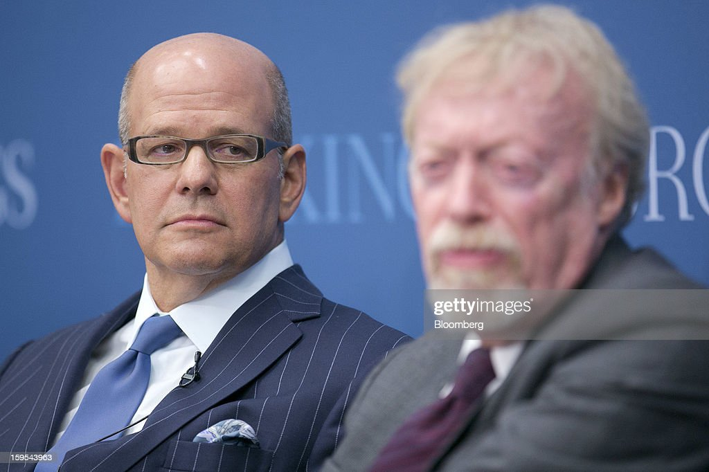 Robert Taubman, chairman, president and chief executive officer of Taubman Centers Inc., left, looks on as <a gi-track='captionPersonalityLinkClicked' href=/galleries/search?phrase=Phil+Knight&family=editorial&specificpeople=2278905 ng-click='$event.stopPropagation()'>Phil Knight</a>, chairman and co-founder of Nike Inc., speaks during a panel discussion at the Brookings Institution in Washington, D.C., U.S., on Tuesday, Jan. 15, 2013. The event was titled 'Fostering Growth Through Innovation.' Photographer: Andrew Harrer/Bloomberg via Getty Images