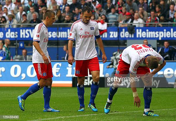 Robert Tesche Heiko Westermann and Slobodan Rajkovic of Hamburg look dejected during the Bundesliga match between Hamburger SV and Borussia...