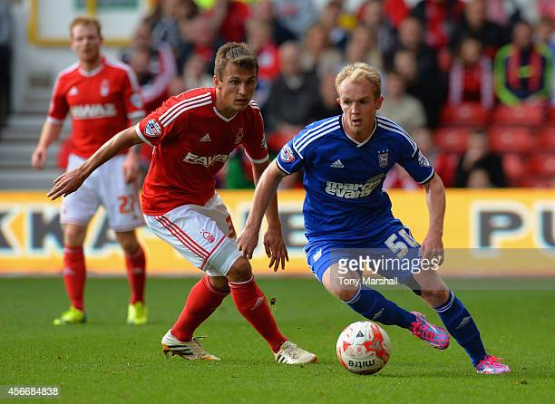 Robert Tesche of Nottingham Forest keeps an eye on Jonny Williams of Ipswich Town during the Sky Bet Championship match between Nottingham Forest and...