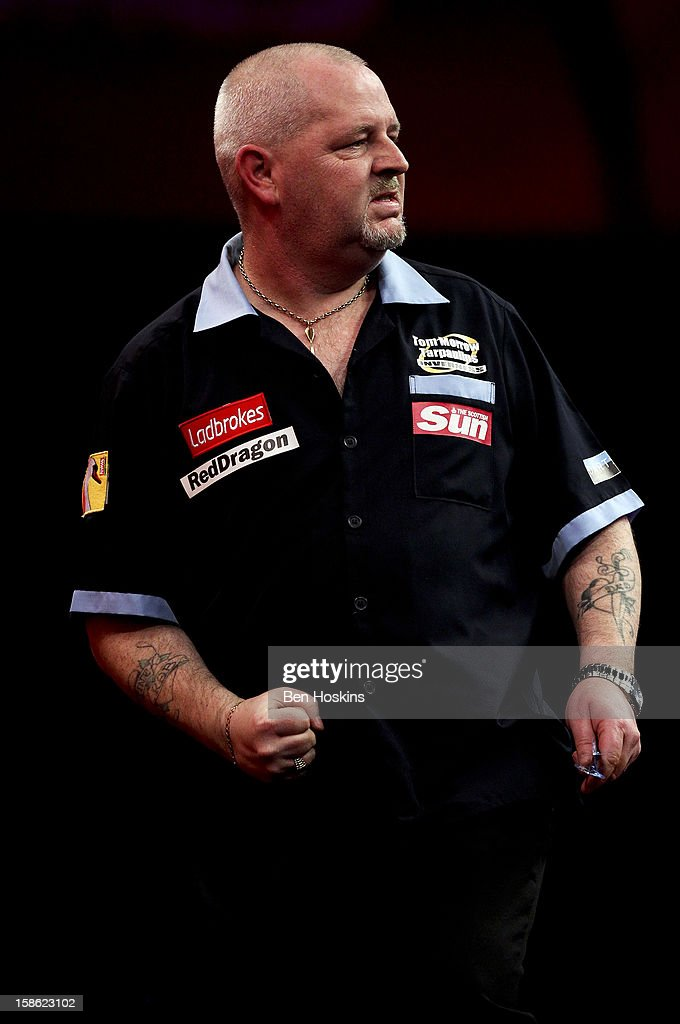 <a gi-track='captionPersonalityLinkClicked' href=/galleries/search?phrase=Robert+Thornton+-+Darts+Player&family=editorial&specificpeople=13849669 ng-click='$event.stopPropagation()'>Robert Thornton</a> of Scotland celebrates during his second round match on day eight of the 2013 Ladbrokes.com World Darts Championship at the Alexandra Palace on December 21, 2012 in London, England.