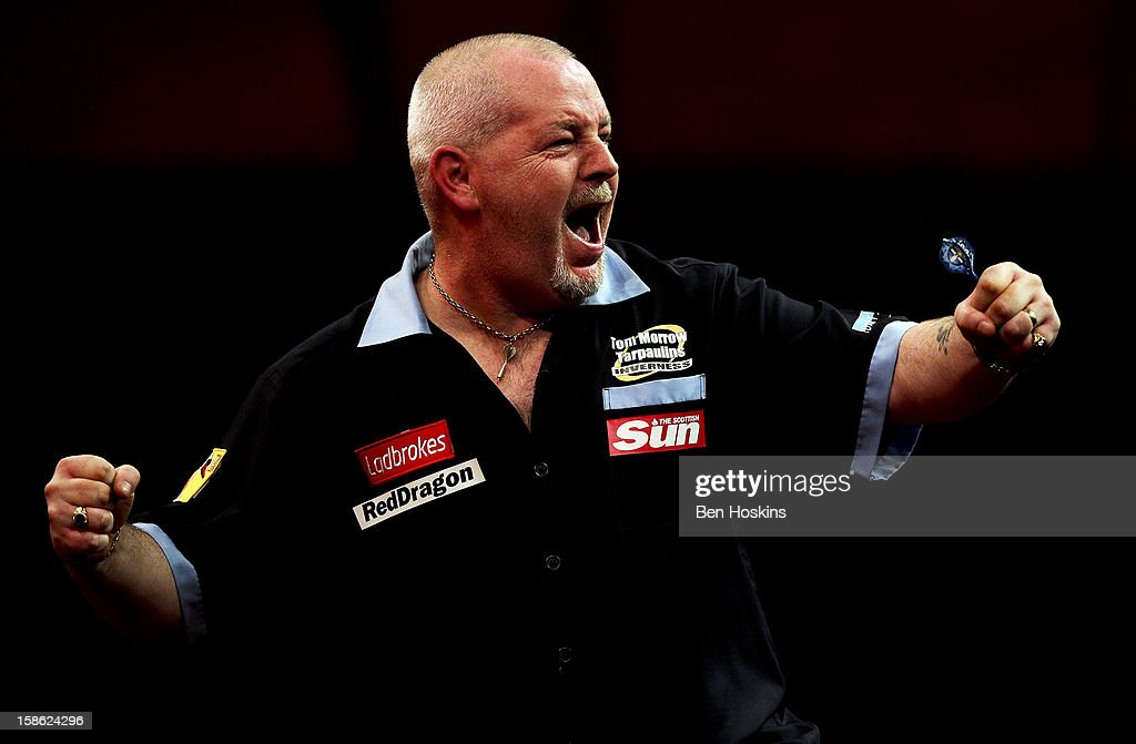 <a gi-track='captionPersonalityLinkClicked' href=/galleries/search?phrase=Robert+Thornton+-+Darts+Player&family=editorial&specificpeople=13849669 ng-click='$event.stopPropagation()'>Robert Thornton</a> of Scotland celebrates his win during his second round match on day eight of the 2013 Ladbrokes.com World Darts Championship at the Alexandra Palace on December 21, 2012 in London, England.