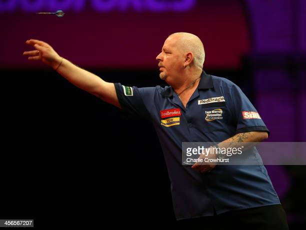 Robert Thornton of Scotland in action during his first round match against Max Hopp of Germany during the Ladbrokescom World Darts Championship on...