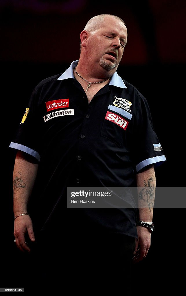 <a gi-track='captionPersonalityLinkClicked' href=/galleries/search?phrase=Robert+Thornton+-+Darts+Player&family=editorial&specificpeople=13849669 ng-click='$event.stopPropagation()'>Robert Thornton</a> of Scotland reacts during his second round match on day eight of the 2013 Ladbrokes.com World Darts Championship at the Alexandra Palace on December 21, 2012 in London, England.