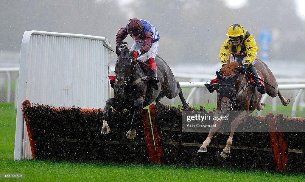 Robert Thornton riding Duroble Man (L) clear the last to win The William Hill - Download The App Juvenile Hurdle Race at Kempton Park racecourse on October 20, 2013 in Sunbury, England.