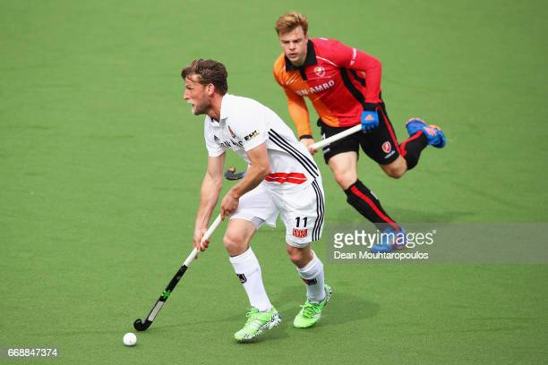 Robert Tigges of AH BC Amsterdam gets past the tackle from Mink Van Der Weerden of HC OranjeRood during the Euro Hockey League KO16 match between HC...