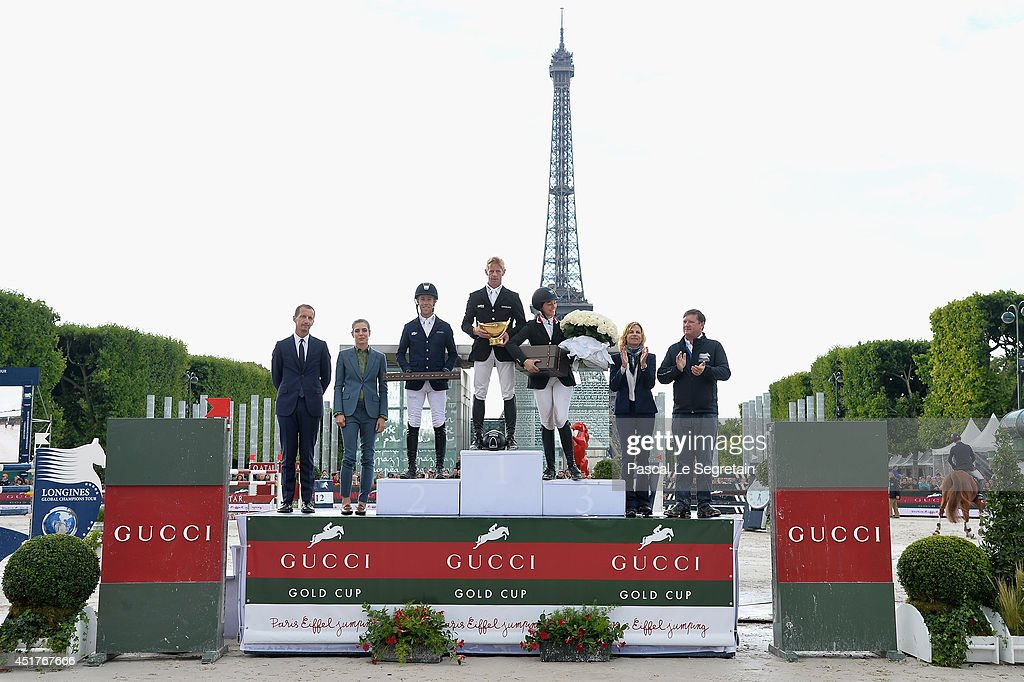 Robert Triefus (L), Charlotte Casiraghi (2L), Virginie Couperie-Eiffel (2R) and Jan Tops (R) pose with the Winners of the 'Gucci Gold Cup Paris Eiffel Jumping Table A against the clock with jump-off ' Maikel van der Vleuten (2nd rank), Marcus Ehning (1st rank) and Reed Kessler (3rd rank) during the Paris Eiffel Jumping presented by Gucci at Champ-de-Mars on July 6, 2014 in Paris, France.