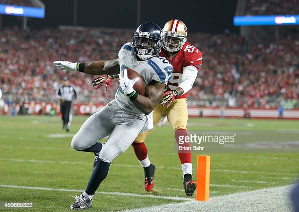 Robert Turbin of the Seattle Seahawks scores the first touchdown against Chris Culliver of the San Francisco 49ers in the first half at Levi's...