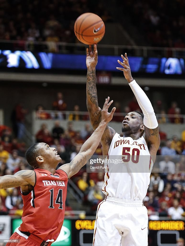 Robert Turner #14 of the Texas Tech Red Raiders blocks as DeAndre Kane #50 of the Iowa State Cyclones puts up a jump shot in the first half of play at Hilton Coliseum on February 15, 2014 in Ames, Iowa. Iowa State defeated Texas Tech 70-64.