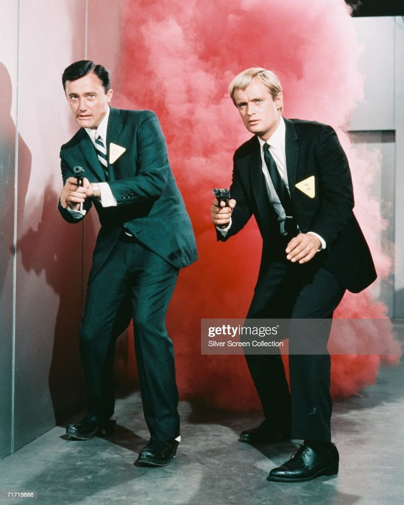 Robert Vaughn as Napoleon Solo and David McCallum as Illya Kuryakin in popular TV series 'The 'Man from U.N.C.L.E.', circa 1965.