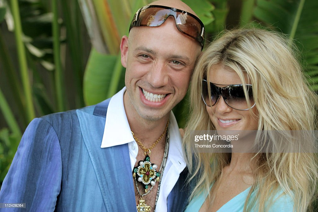 Robert Verdi in Chanel sunglasses with Marisa Miller in Vogue sunglasses