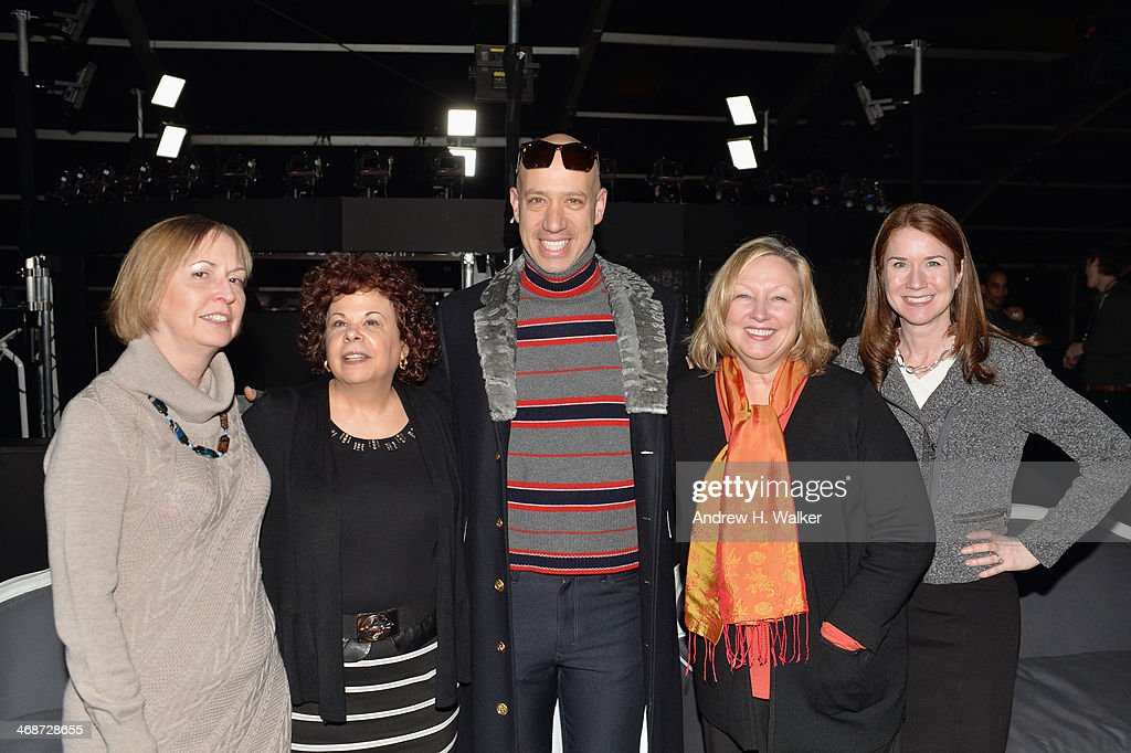 Robert Verdi poses with guests during Mercedes-Benz Fashion Week Fall 2014 at Lincoln Center for the Performing Arts on February 11, 2014 in New York City.