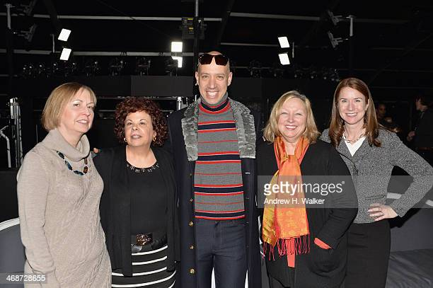 Robert Verdi poses with guests during MercedesBenz Fashion Week Fall 2014 at Lincoln Center for the Performing Arts on February 11 2014 in New York...
