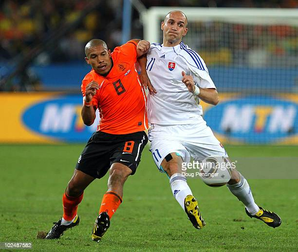 Robert Vittek of Slovakia and Nigel De Jong of the Netherlands challenge for the ball during the 2010 FIFA World Cup South Africa Round of Sixteen...