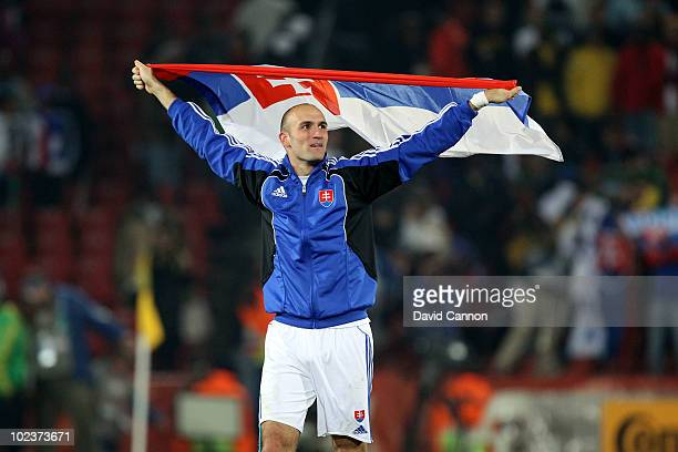 Robert Vittek of Slovakia celebrates victory with his national flag after knocking Italy out of the competition during the 2010 FIFA World Cup South...