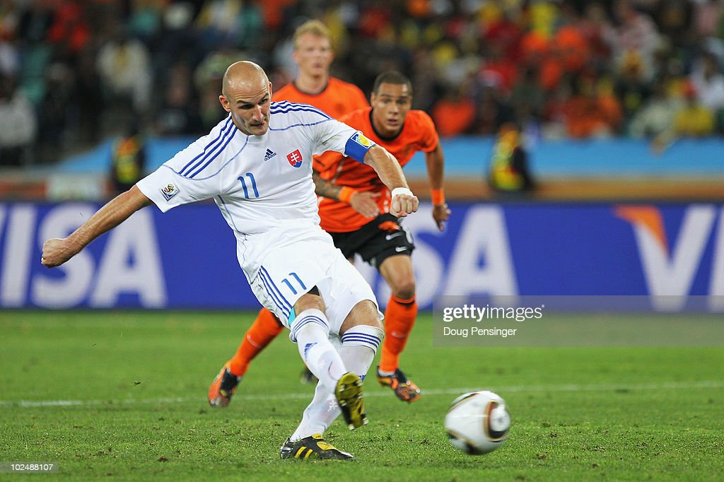 Robert Vittek of Slovakia shoots and scores a late penalty during the 2010 FIFA World Cup South Africa Round of Sixteen match between Netherlands and Slovakia at Durban Stadium on June 28, 2010 in Durban, South Africa.