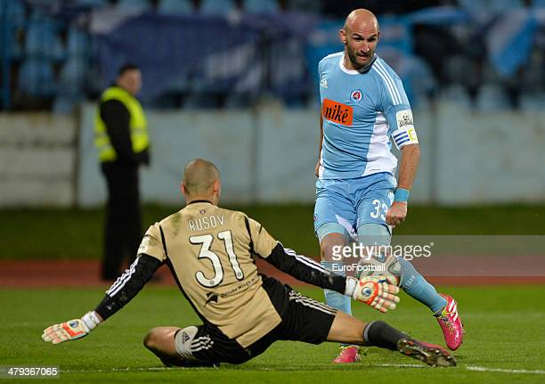 Robert Vittek of Slovan Bratislava shoots at goalkeeper Dobrivoj Rusov of Spartak Trnava during the Corgon liga league football match between Slovan...