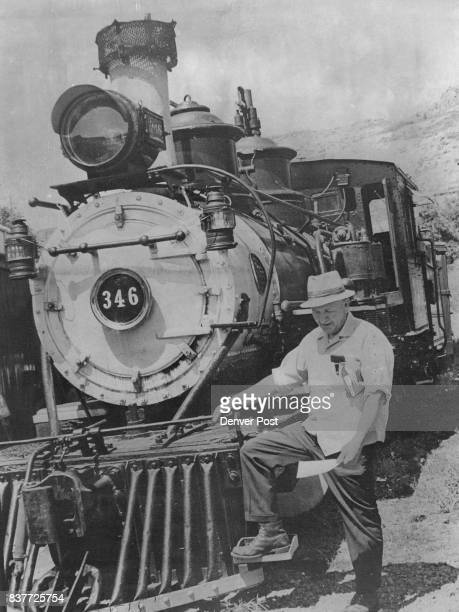 S PUFFING Robert W Richardson executive director and operator of the Colorado Railroad Museum east of Golden reads a ceaseanddesist order against the...