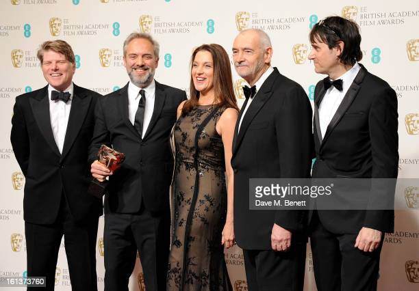 Robert Wade director Sam Mendes Barbara Broccoli Michael G Wilson and Neal Purvis pose in the Press Room after winning Outstanding British Film at...