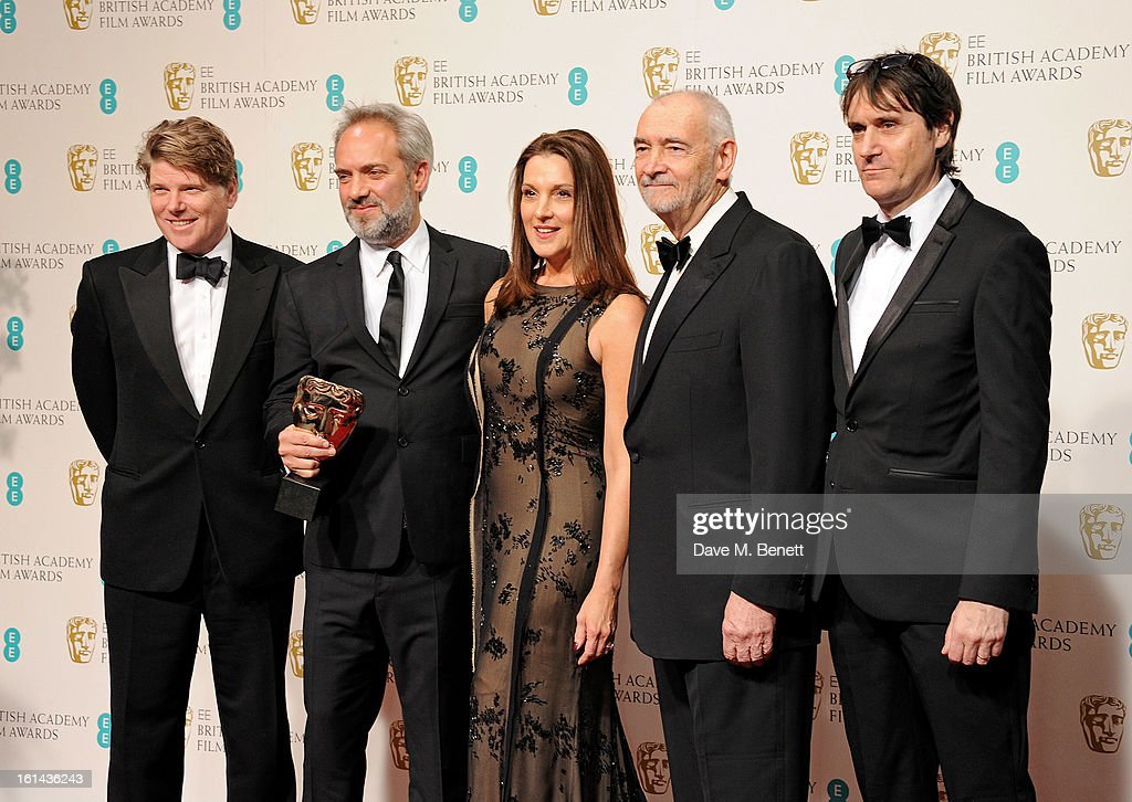 Robert Wade, director Sam Mendes, Barbara Broccoli, Michael G. Wilson and Neal Purvis pose in the Press Room after winning Outstanding British Film at the EE British Academy Film Awards at The Royal Opera House on February 10, 2013 in London, England.