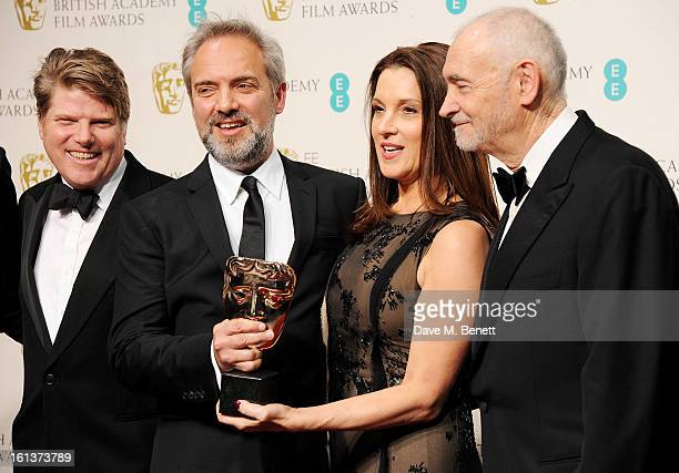 Robert Wade Sam Mendes Barbara Broccoli and Michael G Wilson pose in the Press Room after winning Outstanding British Film at the EE British Academy...
