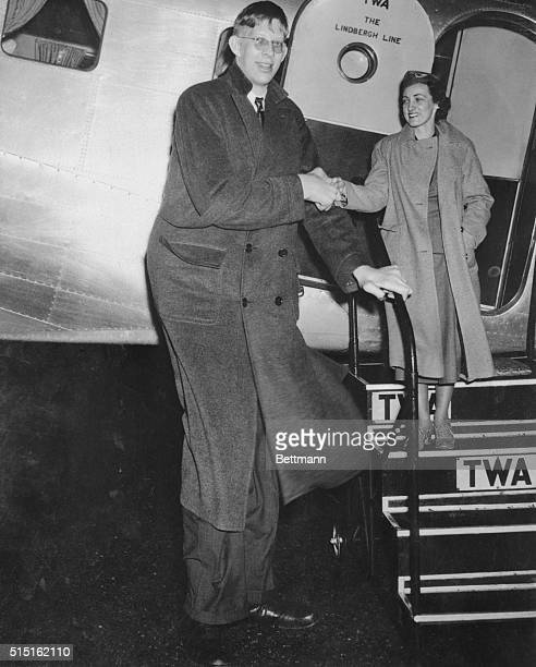 Robert Wadlow young Alton IL man who will appear with a well known circus pictured as he arrived in New York from Chicago April 5th aboard a TWA...