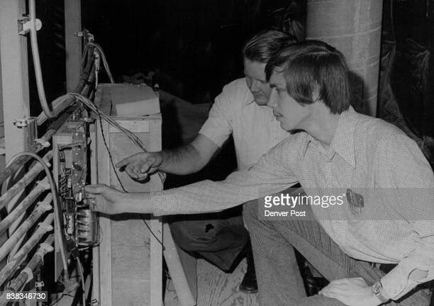 Robert Wallace left chief electronics engineer and technician Michael Thornton prepare to remove programmers used in last show at planetarium Credit...