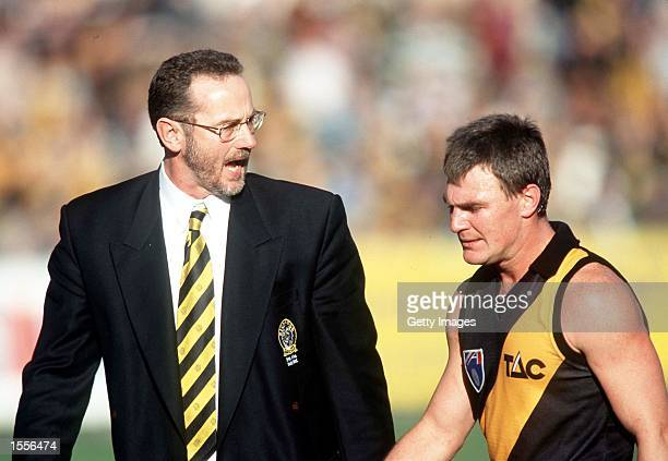 Robert Walls Coach of Richmond has words with Paul Broderick in the match between Richmond and Hawthorn during round 15 of the AFL season played at...