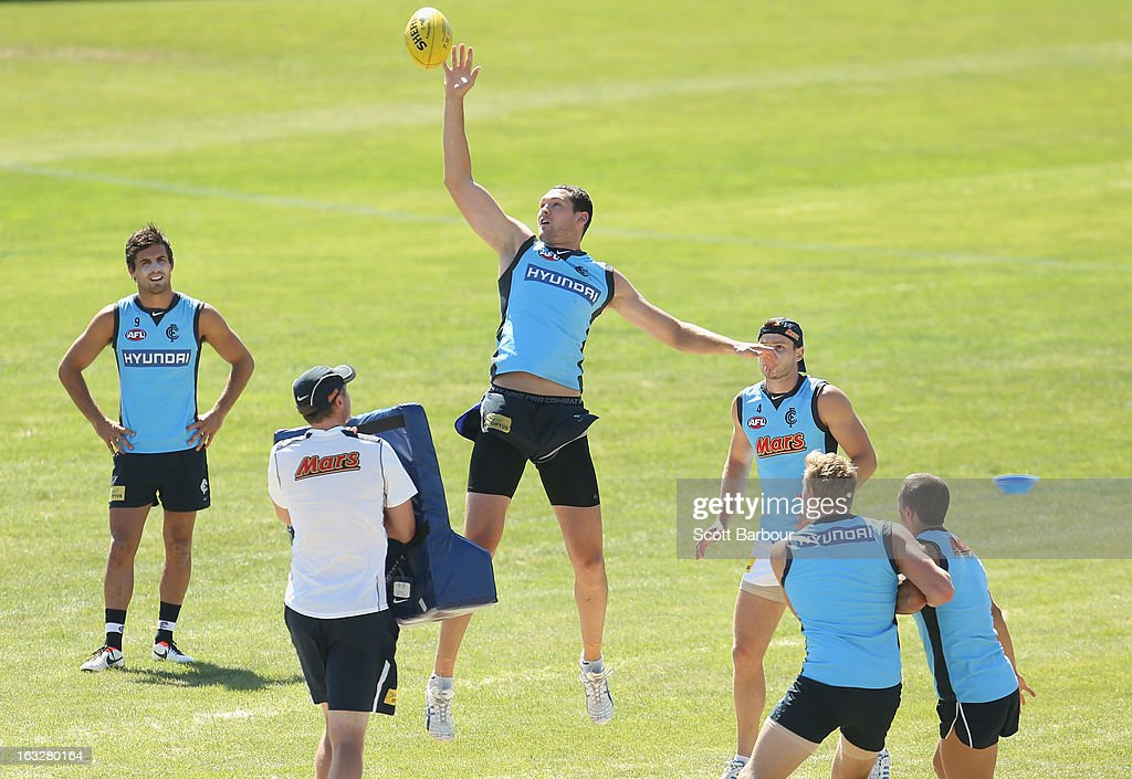 Robert Warnock of the Blues taps the ball during a Carlton Blues AFL training session at Visy Park on March 7, 2013 in Melbourne, Australia.