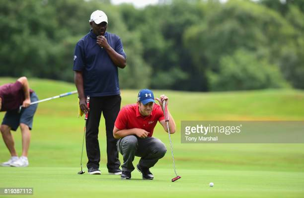 Robert Watson and Tai Bamby of The Shire London line up a putt on the 17th green during the PGA Lombard Trophy East Qualifier at Sandy Lodge Golf...