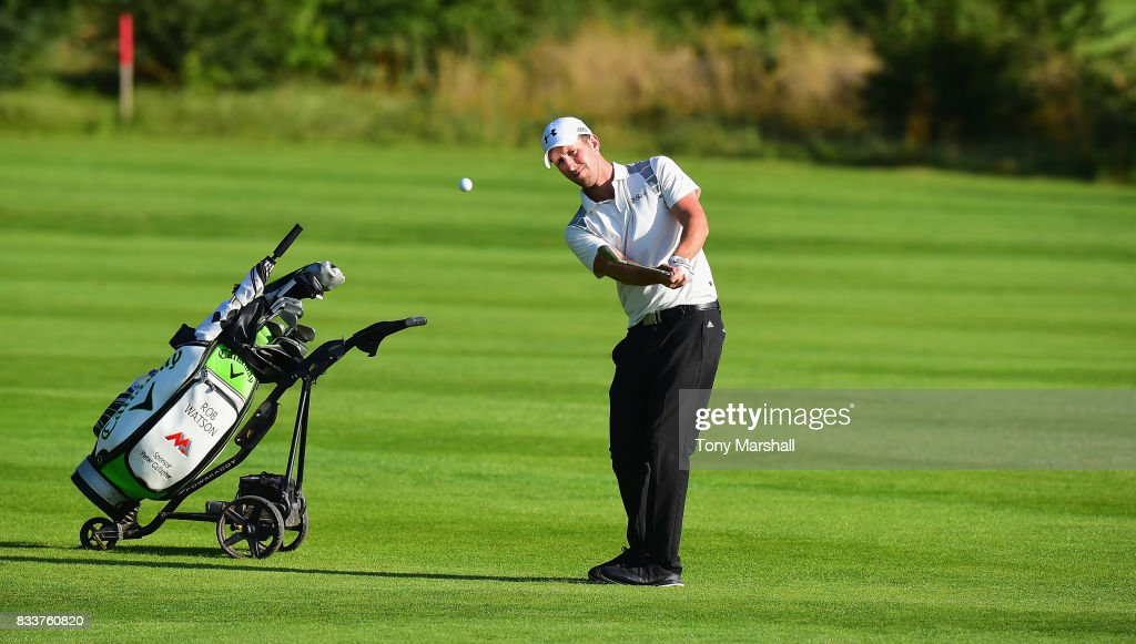 Robert Watson of The Shire London chips on tot he 18th green during the Golfbreaks.com PGA Fourball Championship - Day 2 at Whittlebury Park Golf & Country Club on August 17, 2017 in Towcester, England.