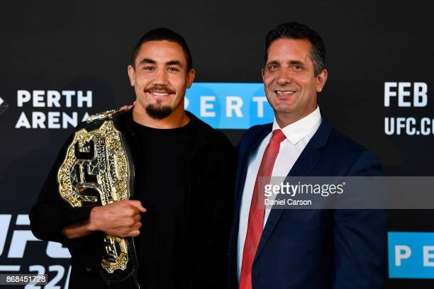 Robert Whittaker and the Minister for Tourism the Honourable Paul Papalia poses for a photo in Perth Arena after the press conference during a UFC...