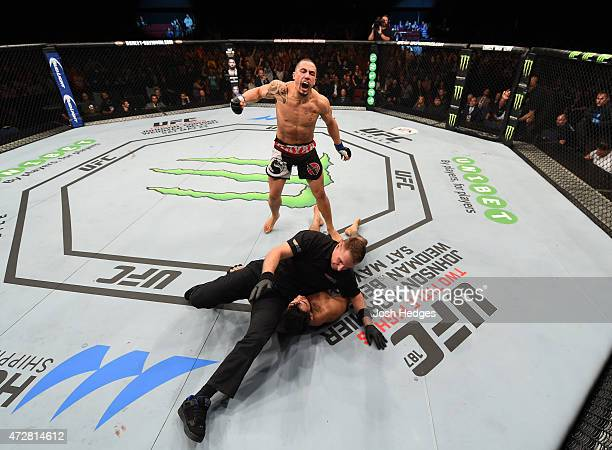Robert Whittaker celebrates his knockout victory over Brad Tavares in their middleweight bout during the UFC Fight Night event at the Adelaide...
