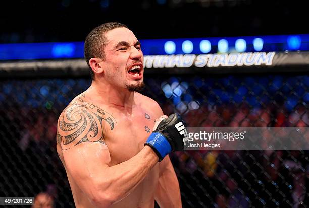 Robert Whittaker celebrates his win by Unanimous Decision against Uriah Hall in their middleweight bout during the UFC 193 event at Etihad Stadium on...