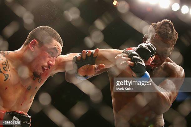 Robert Whittaker connects with a left to the face of Clint Hester in their middleweight fight during the UFC Fight Night 55 event at Allphones Arena...